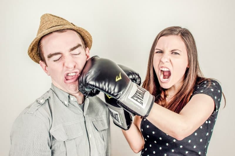people boxing to symbolize people fighting over mixing with headphones