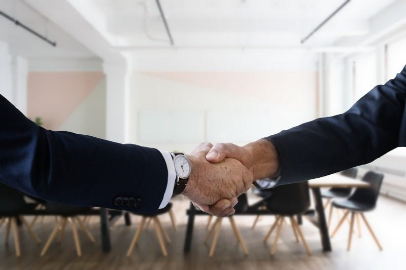 shaking hands with a music licensing representative